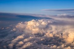 Heaven like clouds seen from above, airplane view. At sunrise royalty free stock image