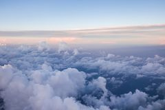 Heaven like clouds seen from above, airplane view. At sunrise stock images