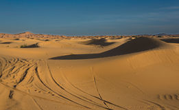 Heaven and sand. Erg Chebbi is one of Morocco's two Saharan ergs – large dunes formed by wind-blown sand –. The other is Erg Chigaga near M'hamid. Its Stock Photo
