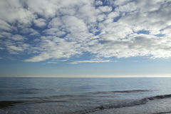 Heaven with stratocumulus clouds over sea Stock Photo