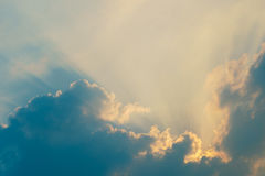 Heaven sunlight rays behind clouds Royalty Free Stock Photos
