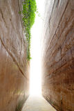 Heaven sunny light between hugh stone age wall Royalty Free Stock Images