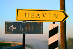 The life signpost guidepost. Signpost to heaven and hell Royalty Free Stock Photo