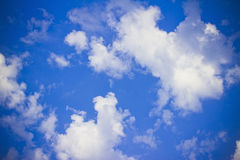 Heavenly bright blue sky with fluffy clouds. Bright blue sky and fluffy clouds looking serene, heavenly Stock Image