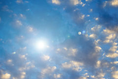 Heavenly bright blue sky with sun flare. Bright blue sky and sun light rays looking serene, heavenly Royalty Free Stock Image