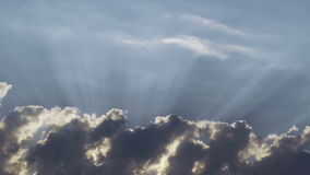 Heavenly clouds with sun rays Stock Images