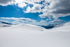 Heavenly cloudscape over snowy mountains Stock Images