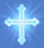 Heavenly cross. Brilliant decorated in a pattern, Christian, Latin cross on a blue background radiant Stock Photos