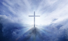 Heavenly Cross. A transparent Cross giving out heavenly light in the sky stock images