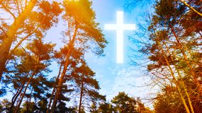 Heavenly Cross . Religion symbol shape .  Dramatic nature background  . Glowing cross in sky . Happy Easter. Light from sky . Religion background .  Paradise royalty free stock image