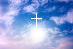 Heavenly Cross . Religion symbol shape . Dramatic nature background. Glowing cross in sky . Happy Easter. Light from sky . Religion background . Paradise heaven royalty free stock image