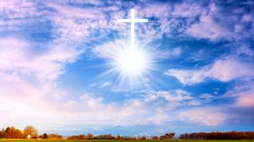 Heavenly Cross . Religion symbol shape . Dramatic nature background. Glowing cross in sky . Happy Easter. Light from sky . Religion background . Paradise heaven stock photo
