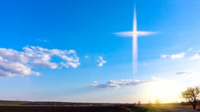 Heavenly Cross . Religion symbol shape .  Dramatic nature background stock photo