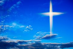 Heavenly Cross . Religion symbol shape .  Dramatic nature background. Glowing cross in sky . Happy Easter. Light from sky . Religion background .  Paradise royalty free stock photo