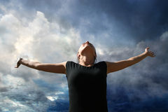 Heavenly Fall. A woman takes a back dive or fall from the heavenly skies or heavenly enjoyment Stock Photos