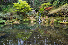 Heavenly Falls and the Swirly Lower Pond. Heavenly Falls and the swirly pond at Portland Japanese Garden in Springtime Stock Image