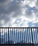 Heavenly handrail. Handrail with cloudy sky stock photography