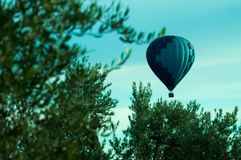 Heavenly hot air balloon flying high in the sky royalty free stock image