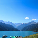 Heavenly lake with sightseeing cruises Royalty Free Stock Image