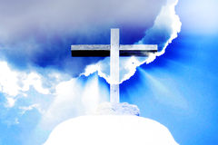 HEAVENLY LIGHT. Cross illuminated by heavenly light Royalty Free Stock Image