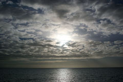 Heavenly light. Beautiful skies with reflection on the ocean stock photography