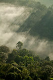 Heavenly light on hills. Sun rays shining through stormy clouds Royalty Free Stock Image