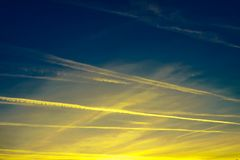 Heavenly racetrack. The racing track of planes illuminated by the sunset. Magic view royalty free stock image