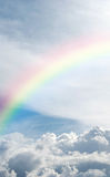 Heavenly rainbow. A heavenly rainbow set against a beautiful cloudscape Stock Image