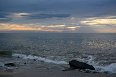 Heavenly Skies above the Ocean. The sunrises over the ocean on a summer morning beach walk at dawn Stock Photography