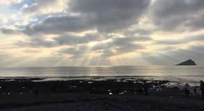 Heavenly skyline over Devon beach stock photo