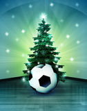 Heavenly space with soccer ball under glittering xmas tree Royalty Free Stock Image