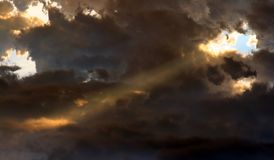 Heavenly Spotlight. A hole in the clouds of a thunderstorm gave the sun's rays a chance to make this natural spotlight Stock Images