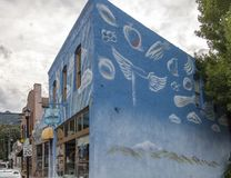 Heavenly Squeeze in Manitou Springs, Colorado. Manitou Springs, CO/USA - September 7, 2016 - A mural on the side of Ruffrano`s Heavenly Squeeze and Oxygen Bar in Royalty Free Stock Photos
