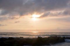 Heavenly Summer Sunrise Over Rock Jetty on the Beach Stock Photos