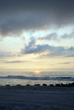 Heavenly Summer Sunrise Over Wooden Pier on the Beach Royalty Free Stock Photo