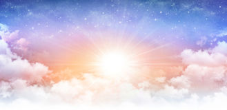 Heavenly sunny sky. Heavenly sky, sun breaking through white clouds and stars shining behind Royalty Free Stock Photo