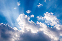 Heavenly sunrays through clouds. Religious symbol royalty free stock image