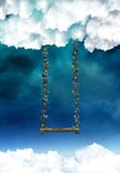 Heavenly Swing. A swing dangling from the clouds, for artists and designers to use in their projects Stock Images