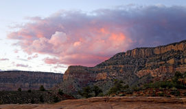 Heavenly Waves. Colorful waves of sunset clouds crest over the North Rim of Grand Canyon Royalty Free Stock Photos