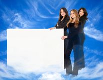 Heavenly women with banner Royalty Free Stock Photos
