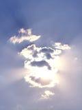 Heavens. Sun shining through clouds Stock Photo