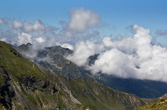 In the heavens. Clouds over Fagaras Mountains , regard to Doamnei (Lady) peak Stock Image