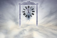 Heavens Gate. Doorway with a roman numeral clock in the clouds Royalty Free Stock Images
