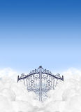 Heavens Gates In The Clouds. A depiction of the gates to heaven in the clouds shut under a clear blue sky background Stock Images