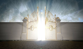 Heavens Gates Opening. A depiction of the pearly gates of heaven opening with the bright side of heaven contrasting with the duller foreground Royalty Free Stock Photos