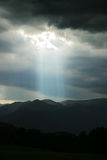 Heavens Spotlight. Opening in rain clouds creats a natural spotlight Stock Image