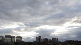 Heavens Turn to Black Over City 1. A time-lapse of nearly two hours of a cloudy summer sunset over Mississauga, Ontario, Canada. With beams of sunlight and stock video