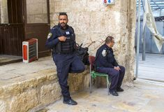 Heavily armed Israeli security forces on duty among tourists at The Dome of the Rock on the Temple Mount in Jerusalem royalty free stock photo