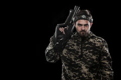 Heavily armed masked paintball soldier isolated on black background. Ad concept. Copy space stock photo