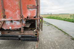 Heavily damaged red container on a trailer Royalty Free Stock Photos